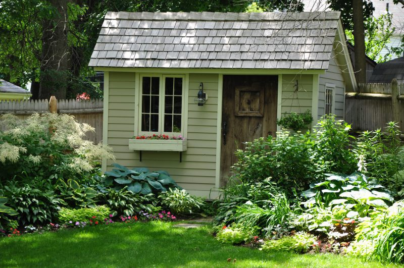 Garden shed, antique door, cedar wood roof will add charm to any garden!
