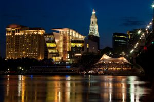 Downtown Hartford at Night, featuring the Connecticut Science Center, The Travelers Tower, Riverfront music tent, and the Connecticut River. Photo Credit