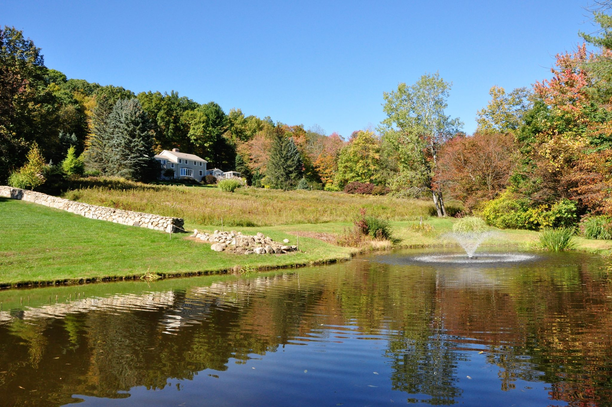 View of pond and exterior of 208 Westledge West Simsbury