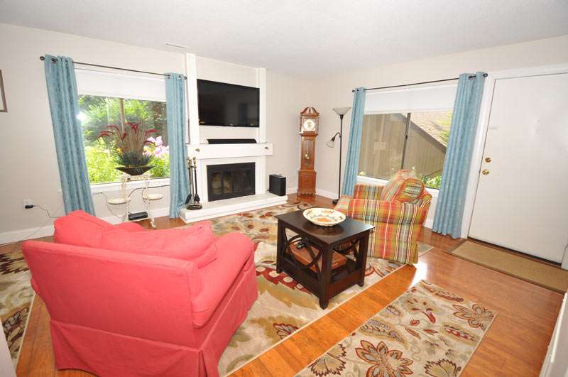 Sun filled living room and open floor plan to dining room. 7 Canterbury Lane, Avon, CT 06001